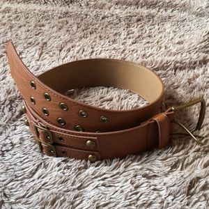 Double buckle wide faux leather belt with grommets